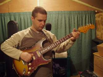Phil playing his Strat in the studio